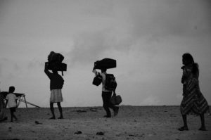 Refugees carrying possessions