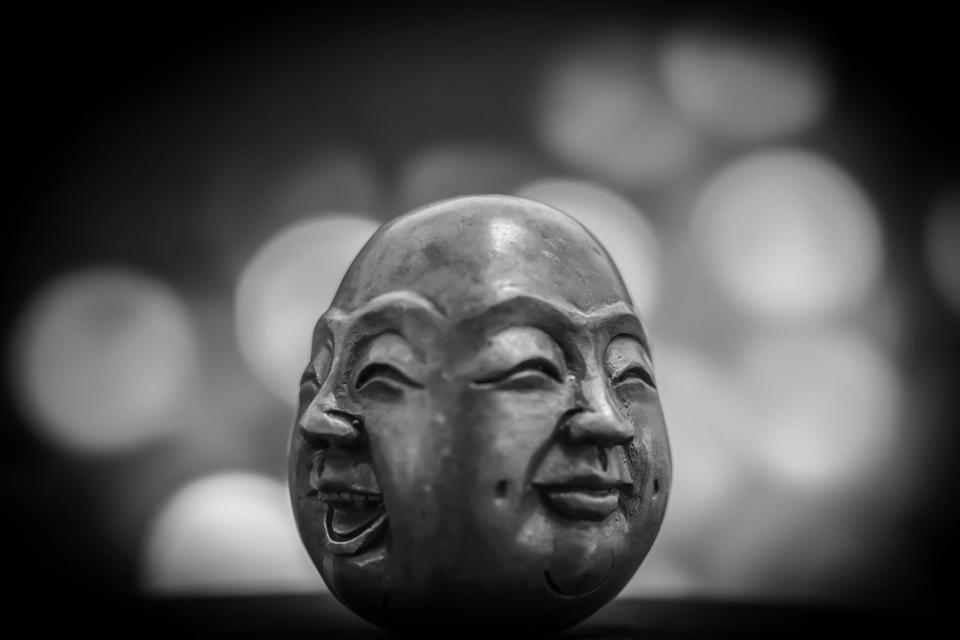 2 faces on a Buddha bust