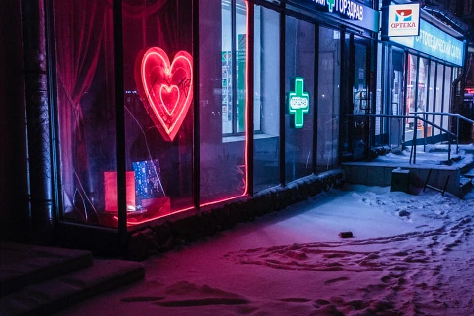 Neon heart sign in pharmacy window